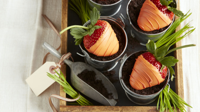 Chocolate covered strawberry carrots in chocolate dirt